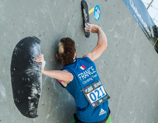 French climber Manu Cornu grabs the top hold as a gaston during the semifinals in Munich 2016